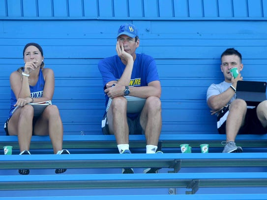 (left to right)Missy Arenz, an assistant coach, sits