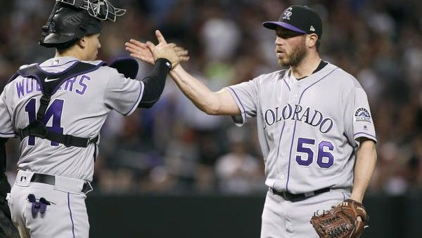 Will Colorado closer Greg Holland, right, be back with the Rockies?