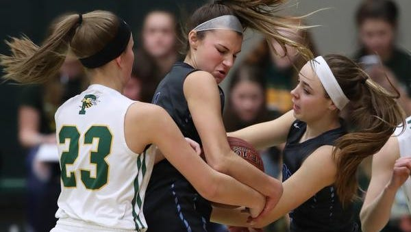 Bay Port's Grace Krause and McKenzie Johnson wrestle the ball from Preble's Madison Hunt in FRCC girls basketball action at Preble High School Friday, February 9, 2018 in Green Bay, Wis.