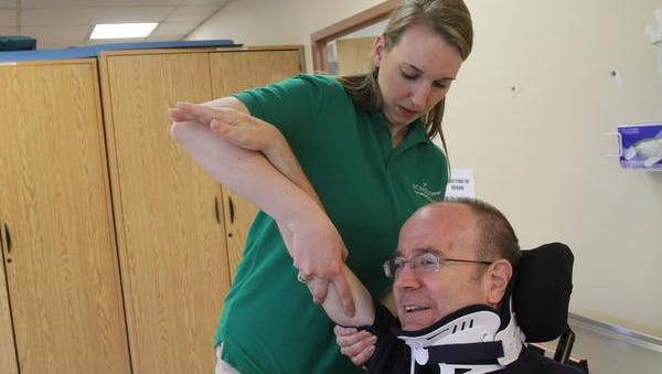 Occupational therapist Ashley Decker works with Bill Keenan during a physical therapy session at Achieve Rehabilitation Center in Liberty, N.Y. April 29, 2014. He was treated there after being discharged from Helen Hayes Hospital.