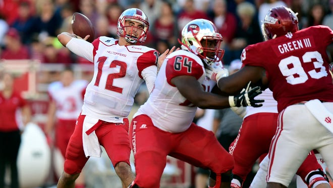 Western Kentucky Hilltoppers quarterback Brandon Doughty (12) throws a pass during the first half of the game against the Indiana Hoosiers at Memorial Stadium.