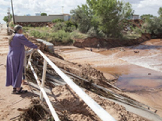Chris Caldwell / The Spectrum & Daily News Residents of Short Creek observe damage and debris caused by a flash flood which claimed multiple lives Sept. 15. Residents of Short Creek observe damage and debris caused by a flash flood which claimed multiple lives Tuesday, Sept. 15, 2015.