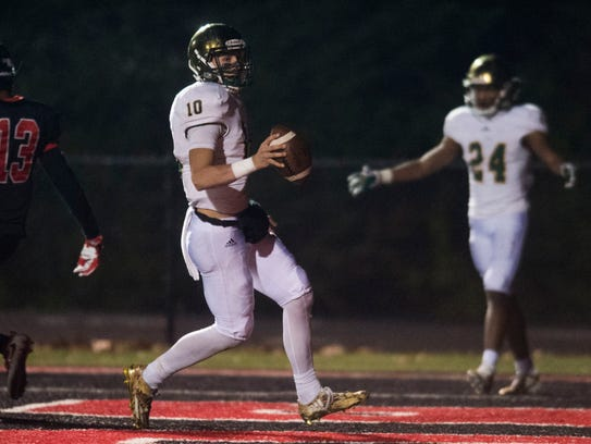 Catholic's Jack Sompayrac (10) runs into the end zone