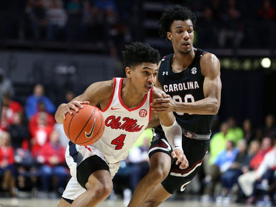Feb 5, 2020; Oxford, Mississippi, USA; Mississippi Rebels guard Breein Tyree (4) drives to the basket as South Carolina Gamecocks guard AJ Lawson (00) defends during the first half at The Pavilion at Ole Miss. Mandatory Credit: Petre Thomas-USA TODAY Sports