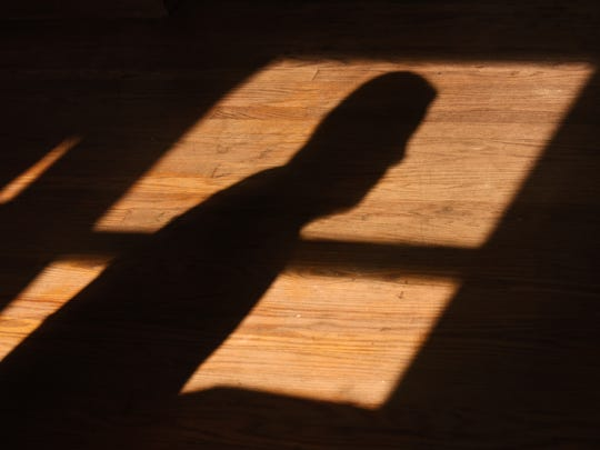 Jose Archaga's shadow in the Dover apartment where his brothers Santos and Daniel Archaga resided.