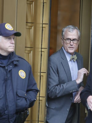 Former North Salem Supervisor Paul Greenwood leaves federal court in Manhattan after being sentenced to 10 years for a massive securities fraud, Dec. 3, 2014.