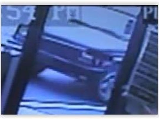 A surveillance photo of the car the suspects may have used.