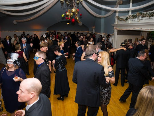 Hundreds danced in 2018 at Masquerade in the Mansion at the Roberson Museum's grand ball oom on New Year's Eve.