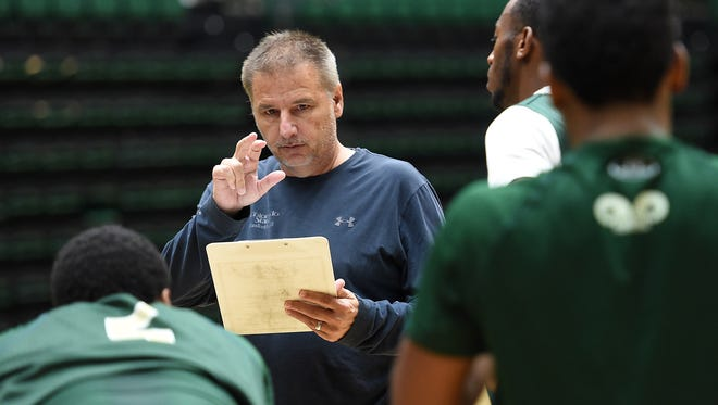 Larry Eustachy talks to players at a Colorado State basketball practice Oct. 23, 2015.