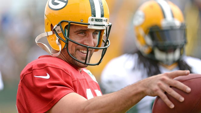 Quarterback Aaron Rodgers reacts during training camp practice at Ray Nitschke Field.