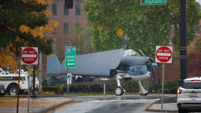 The World War II aircraft makes it way through downtown Worcester. It had been stored at the Worcester Regional Airport and was being moved to the American Heritage Museum in Stow