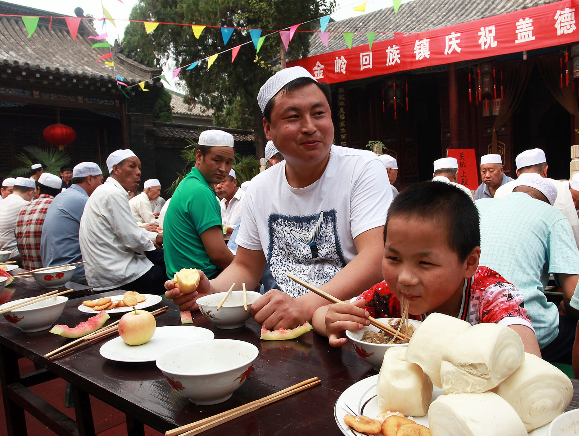 People eat as they celebrate Eid al-Fitr in Zibo, China.