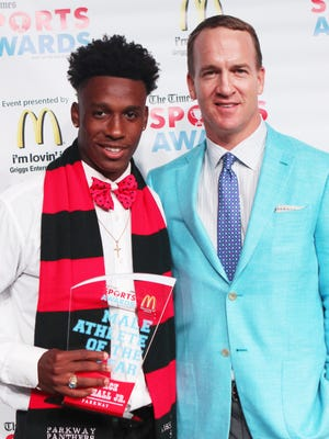 Peyton Manning poses with Male Athlete of the Year Terrace Marshall Jr. (Parkway) at the Shreveport Times Sports Awards at the Shreveport Convention Center in Shreveport, Monday, May 15, 2017.