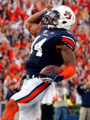 Auburn's Nick Marshall and the Tigers face Alabama on Saturday.
