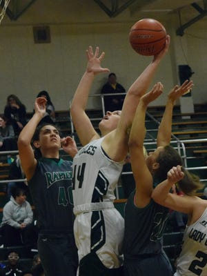 Menard's Emily Feazell (44) comes up with a rebound against Rapides Tuesday.