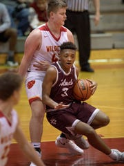 Henderson County's Daymian Dixon (3) loses his footing and collides with Mater Dei's Sam Fulton (40) during their game at the Bosse Winter Classic Saturday afternoon. The Colonels will play in the Traditional Bank Holiday Classic at Lexington Catholic after Christmas.