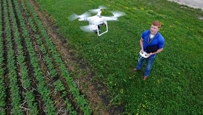 Alan McNeil launches a drone over a soybean field in Bondurant this week.  He pilots the drone to gather aerial video footage for The Peoples Company, a local land brokerage firm.