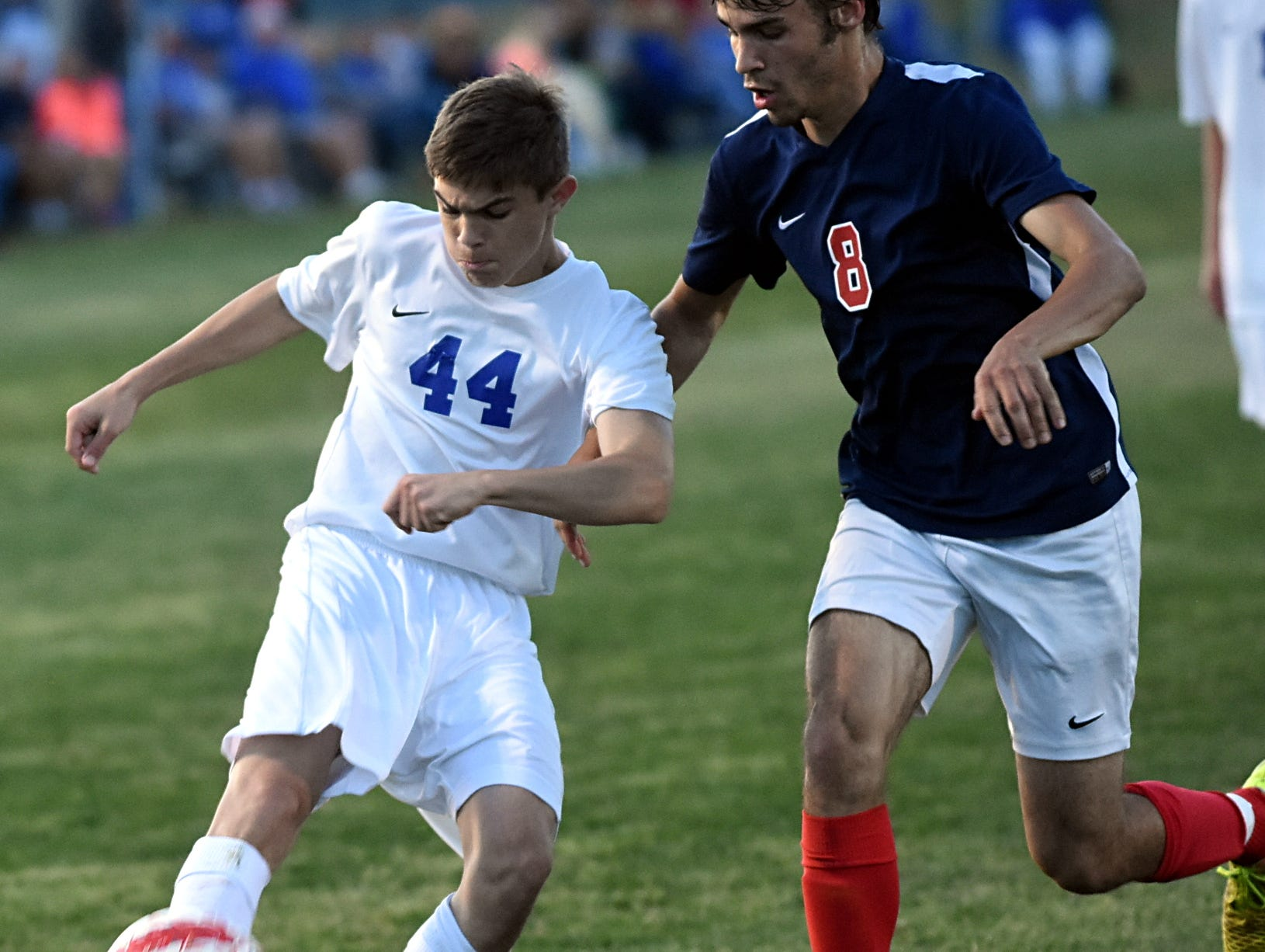 White House High freshman Josh Delaney steps into a first-half shot in front of White House Heritage senior Trent Burian.