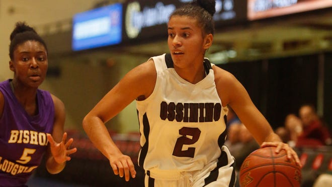 Ossining's Andra Espinoza-Hunter (2) drives the ball during the consolation game against Bishop Loughlin at the18th Annual Slam Dunk Tournament at the Westchester County Center in White Plains on Dec. 29, 2016.  Ossining won 86-64.
