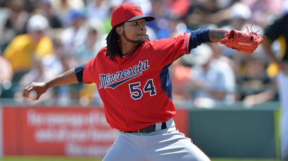 Ervin Santana pitched with the Twins in spring training but then was slapped with an 80-game suspension for PED use.