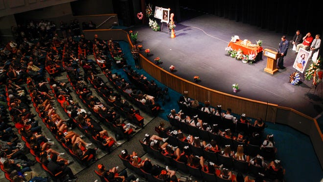 Community members gather for the funeral service for Casey Jordan Marquez on Sunday at the San Juan College Henderson Fine Arts Center Performance Hall in Farmington.