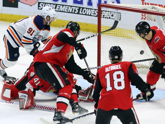 Edmonton Oilers left wing Drake Caggiula (91) shoots the puck past Ottawa Senators goaltender Craig Anderson (41) to score during first-period NHL hockey in Ottawa, Thursday, March 22, 2018. (Fred Chartrand/The Canadian Press via AP)