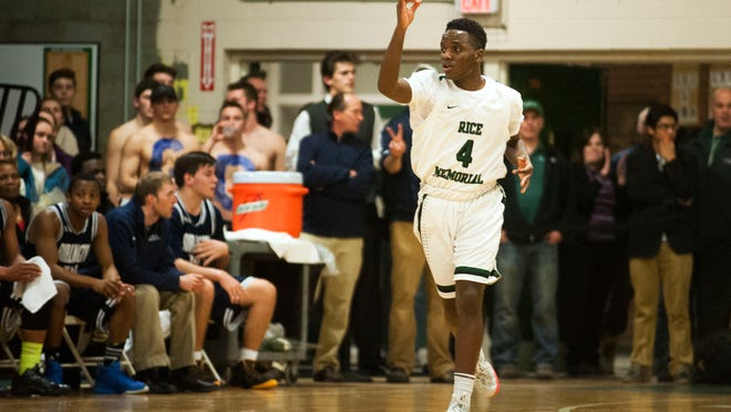 Rice's Arnold Vainqueur (4) celebrates after making a three pointer during a high school boys basketball game earlier this season.