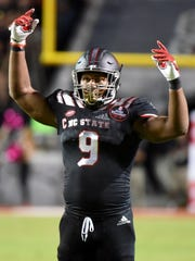 Oct 5, 2017; Raleigh, NC, USA; North Carolina State Wolfpack defensive end Bradley Chubb (9) gestures to the crowd during the first half against the Louisville Cardinals at Carter-Finley Stadium. Mandatory Credit: Rob Kinnan-USA TODAY Sports