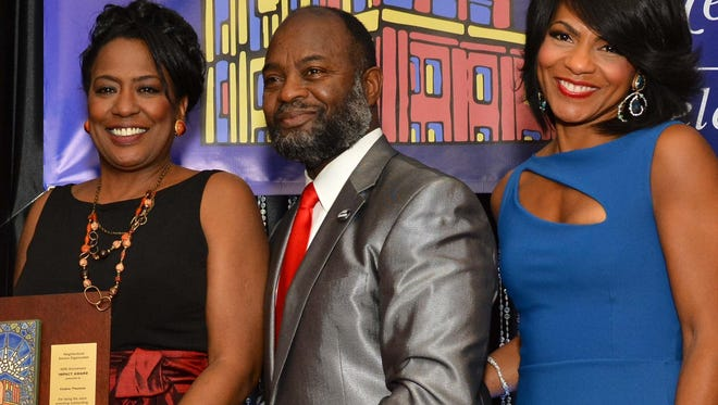 WWJ's Vickie Thomas, left, NSO board chair Ray Johnson and WDIV's Rhonda Walker.