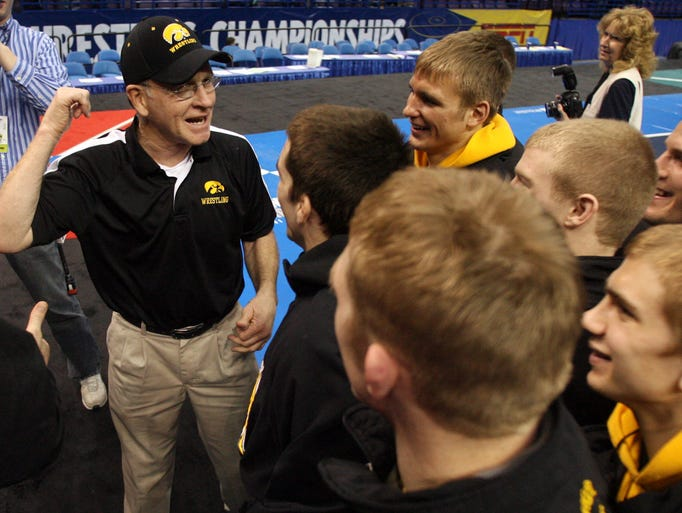 Iowa legend Dan Gable visits with the team on stage after the Hawkeyes won the 2008 NCAA Championships on March 22, 2008, at Scottrade Center in St. Louis.