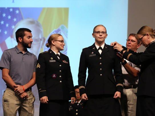 Second Lt. Stephanie Shutak (center) is pinned by her