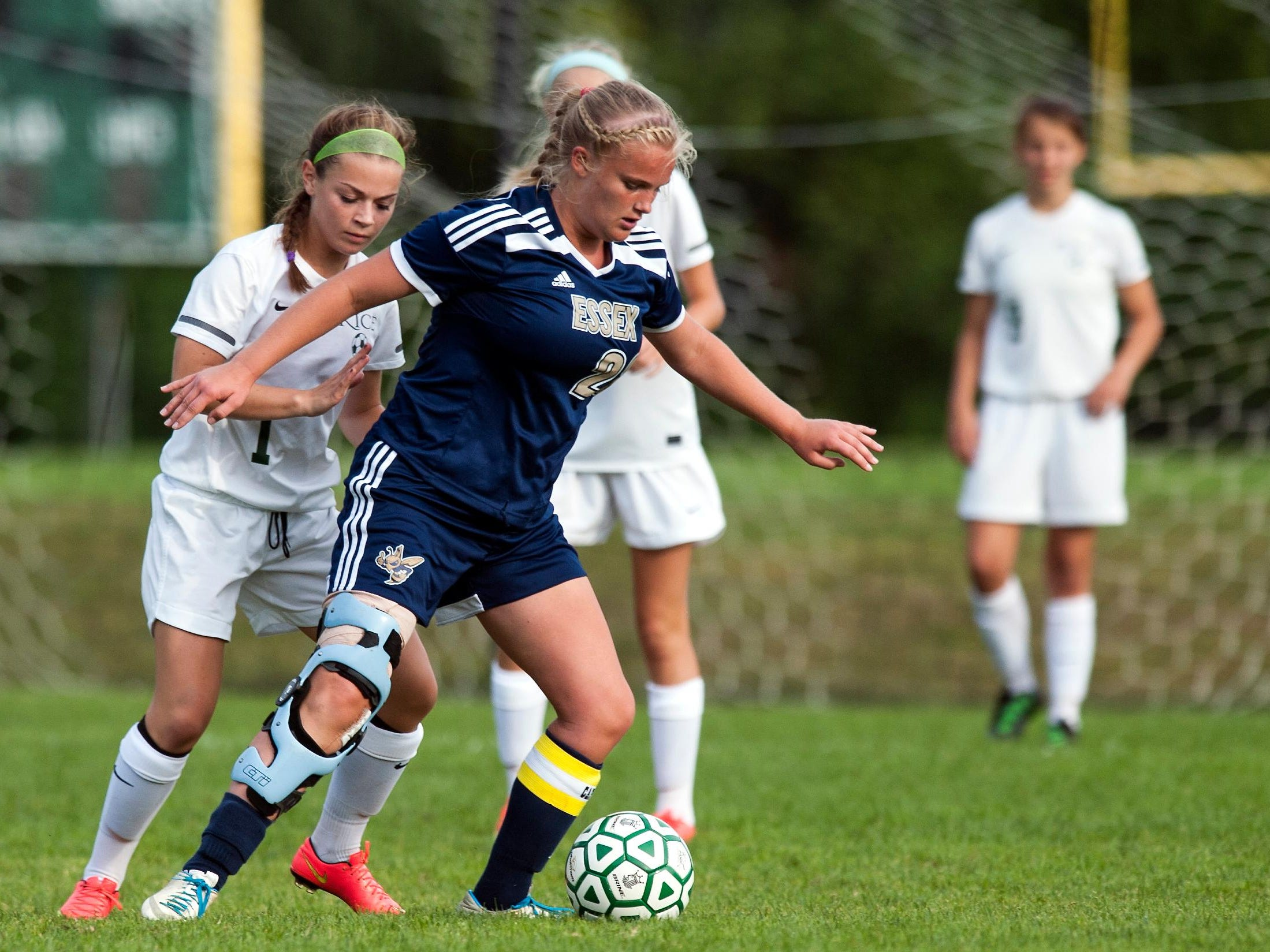 Essex's Megan Macfarlane (20) controls the ball during the girls soccer game between the Essex Hornets and the Rice Green Knights at Rice High School on Wednesday afternoon in 2014.