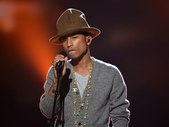 """Recording artist Pharrell Williams performs onstage during """"The Night That Changed America: A GRAMMY Salute To The Beatles"""" at the Los Angeles Convention Center on January 27, 2014 in Los Angeles, California."""