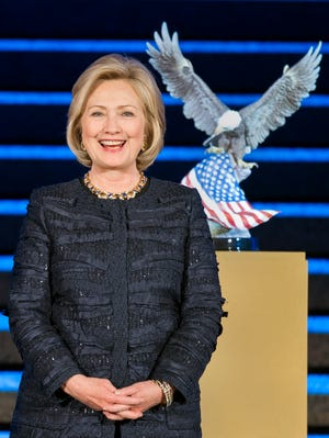 Former Secretary of State Hillary Rodham Clinton has won a lot of awards recently. Here she receives the National Defense University Foundation American Patriot Award in Washington, D.C., on Nov. 14.