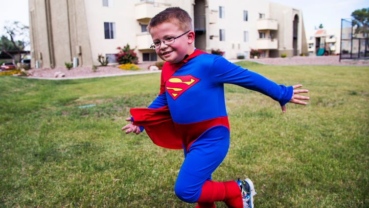 """Dylan Marshall, 5, """"flies"""" in his Superman costume"""