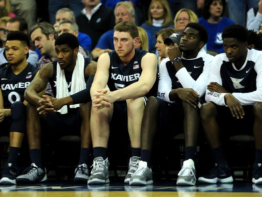 A dejected Xavier Musketeers bench watches action during