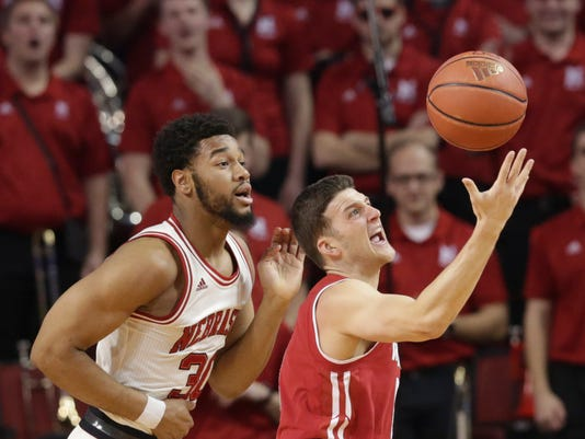 Wisconsin's Zak Showalter (3) and Nebraska's Ed Morrow (30)] compete for a rebound during the first half of an NCAA college basketball game in Lincoln, Neb., Thursday, Feb. 9, 2017. (AP Photo/Nati Harnik)