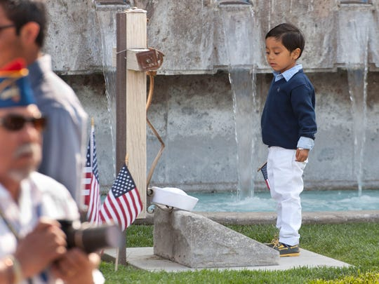 A boy stands at the gravesite of Cesar Chavez before the U.S. Navy ceremony recognizing Cesar Chavez with graveside honors in the Memorial Garden of the Cesar E. Chavez National Monument in Keene on Thursday, April 23, 2015. Chavez served in the Navy from 1946 to 1948. Thursday was the 22nd anniversary of Chavez' death.