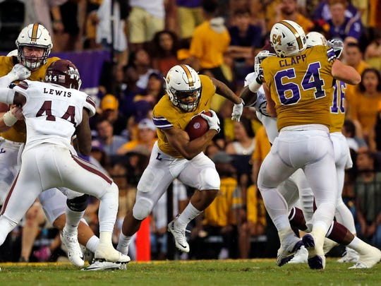 LSU running back Derrius Guice (5) carries in the first