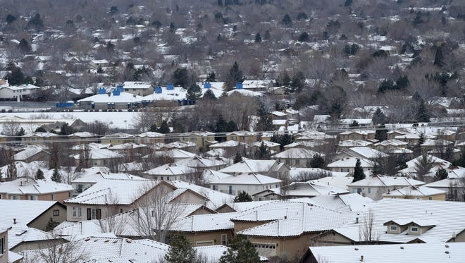 Roofs on homes in Sparks show a light covering of snow from the early morning snowfall on Monday Feb. 12, 2018.