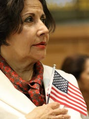Lucrecia Arbelaez Salazar is shown during the Pledge of Allegiance in Jersey City, Wednesday, February 22, 2017. Salazar was one of 26 people who had just become American citizens.