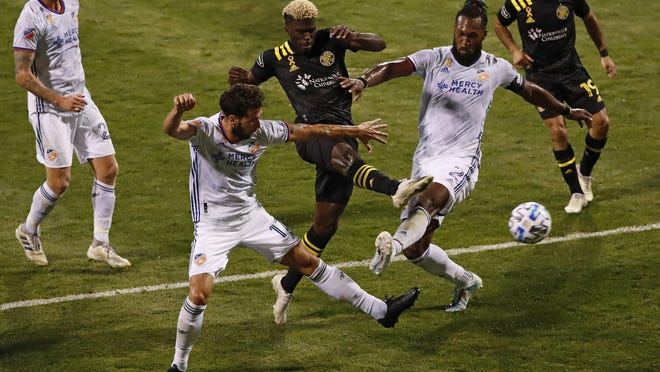 Columbus Crew SC forward Gyasi Zardes (11) scores his second goal of the game between FC Cincinnati defender Mathieu Deplagne (17) and defender Kendall Waston (2) during the second half of the MLS soccer match at Mapfre Stadium in Columbus on Sunday, Sept. 6, 2020.