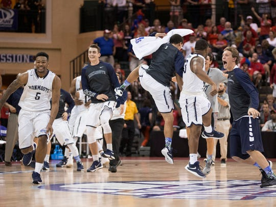 Monmouth players celebrate a 70-68 win over Notre Dame in an NCAA college basketball game Thursday, Nov. 26, 2015, in Orlando, Fla. (AP Photo/Willie J. Allen Jr.)