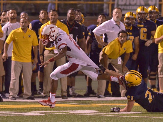 Julian Thornton eludes a Fordson tackler to score Canton's