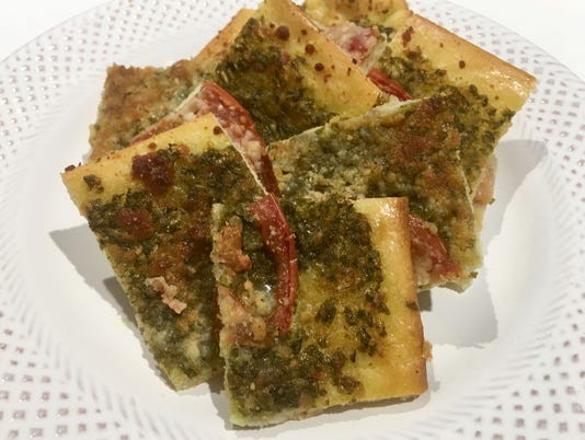 636687376180058930-Pesto-and-tomato-pizza-bite.jpg
