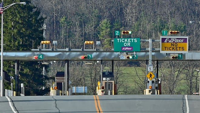 No vehicles are seen at the Pa. Turnpike toll booths near Fannettsburg on Monday, but motorists should expect a very different view starting late today. More vehicles are expected to be on the roads this Thanksgiving than in the past several years.