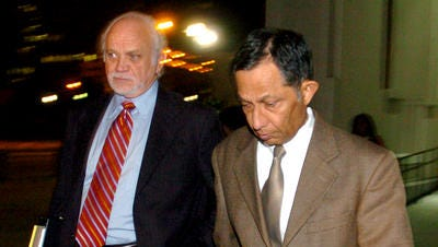Dr. Mehmood Patel, left, leaves the federal courthouse in Lafayette with his attorney, Thomas Guilbeau, in a 2008 photo.