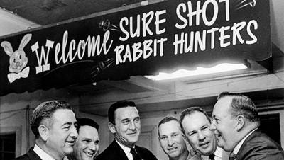 Fate Thomas, right, holds court at the Sure Shot Rabbit Hunters Supper on Feb. 7, 1967.