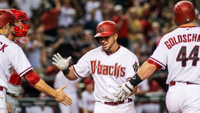 Arizona Diamondbacks left fielder David Peralta (6) is congratulated by teammates after hitting a grand slam bringing the Diamondbacks further ahead of the Phillies 11-1 in the 2nd inning at Chase Field on Tuesday, August 11, 2015, in Phoenix, AZ.