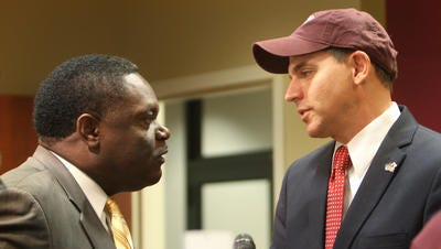 Wickstrom (right) visits with Monroe Mayor Jamie Mayo (left) after being introduced as ULM's athletic director in July 2013.